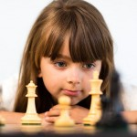 Young girl playing chess